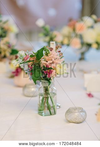 Beautyful Wedding decor. Wedding interior. Festive decor. Bouquet from spring flowers. Table decor. flower composition.