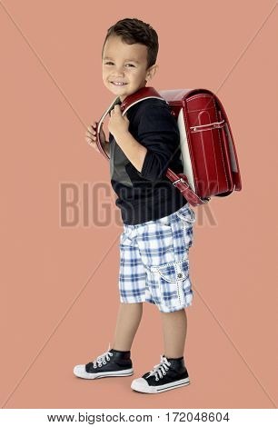 A happy boy is going to school