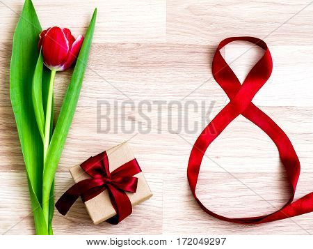 spring flowers, tulips, gift on wooden background