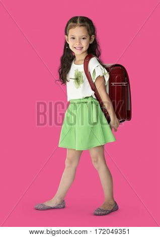 A girl smiling with a school backpack