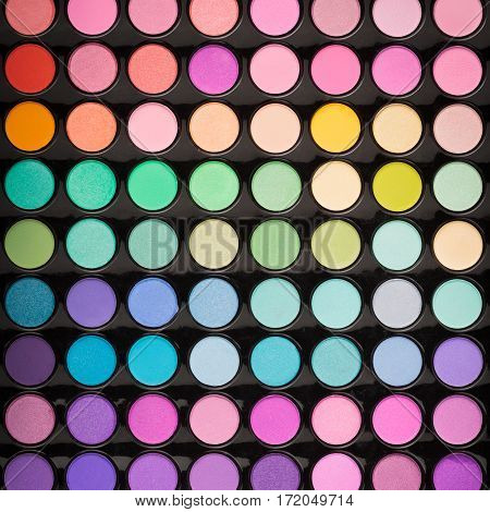Colorful beauty makeup powder background. Makeup eyeshadow palette