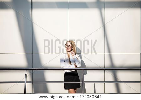 Happy beautiful blonde business woman in modern office. Office concept.