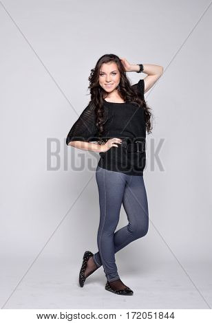 Young beautiful girl standing posing happily smiling