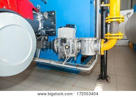 Modern boiler room equipment- high power boiler burner. Boiler room. Water heating. Power supply.