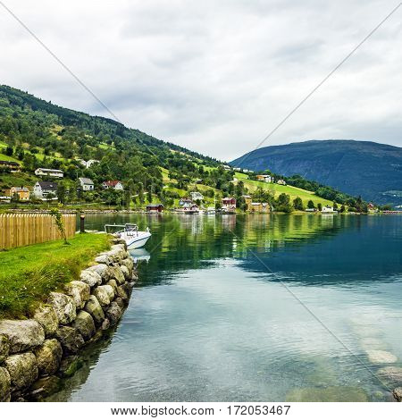 Natural rural landscape. Town and cruise port Olden in Norwegian fjords.