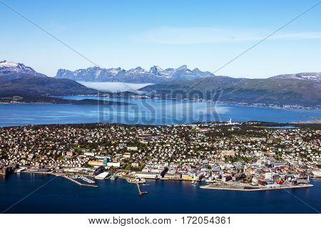 Sea view from mountain on Norwegian city Tromso beyond the Arctic circle.