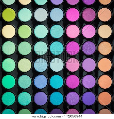 Colorful cosmetic make-up background. Eyeshadow palette texture