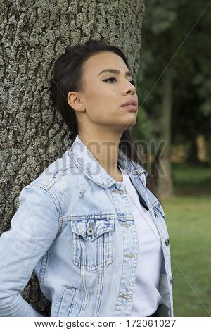 Beautiful young woman walking alone in the park Selective focus and small depth of field