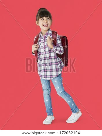 A girl with backpack is smiling