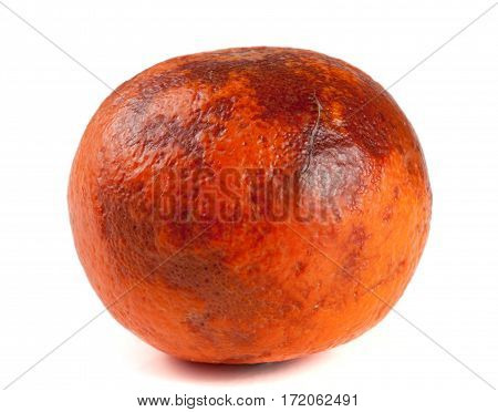 one damaged tangerine isolated on white background.