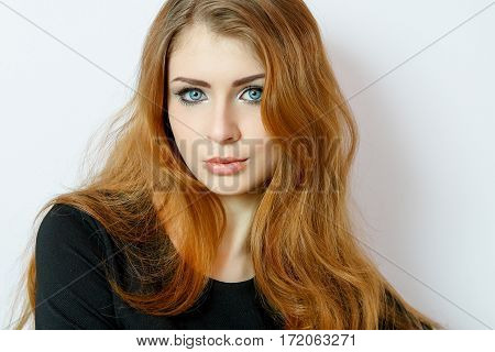 Beauty young woman portrait on white. Beautiful model girl with gentle makeup pink lips perfect fresh skin blue eyes redhead. Youth and Skin Care Concept