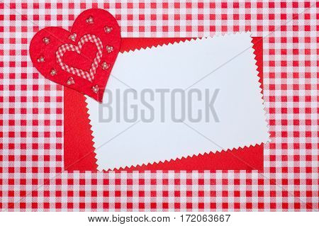 Valentine's Day. Greeting card with a heart on a plaid background
