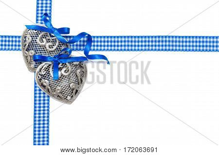 Valentine's Day. Two silver hearts on a white background. Blue checkered ribbons. isolated