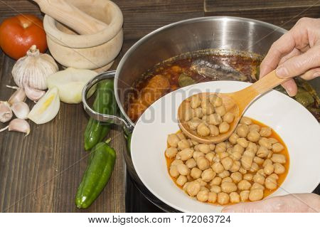 Spanish typical food, chickpeas cooked with vegetables, pork and sausages