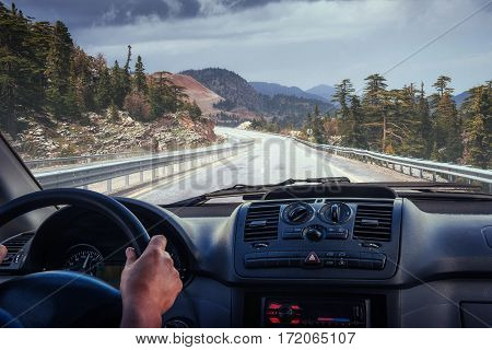 car on the road leading to the mountains. Carpathians. Ukraine. Europe
