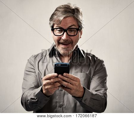 Man reading message on mobile phone