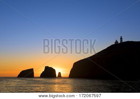 A beautiful sunrise at Anacapa Island in California shows a vibrant orange morning forming as night becomes day.