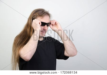 Man in a black shirt and with long hair