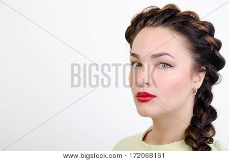 girl with a braid and brightly red lips