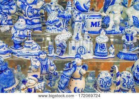 Collection of russian traditional faience utensil in Gzhel style of earthenware