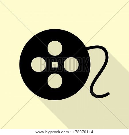 Film circular sign. Black icon with flat style shadow path on cream background.