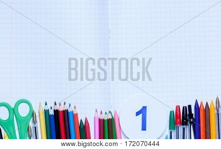 back to school.background.Various school supplies are on the paper sheet.top view.