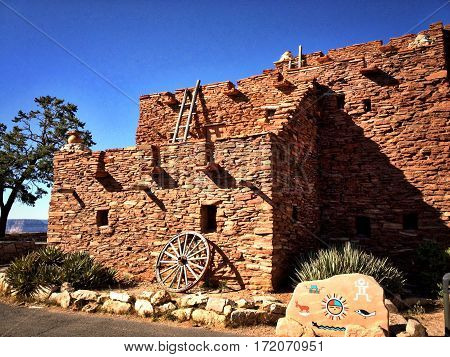 Canyon Pueblo is located on the South Rim of the Grand Canyon. Layered stone and wood ladders.
