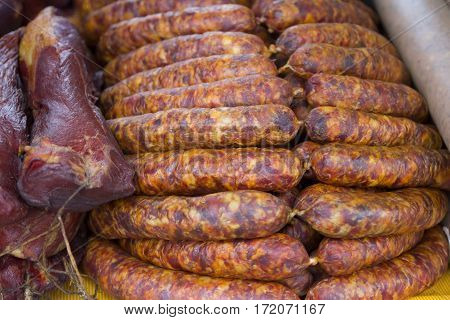 Fresh homemade smoked sausage and smoked meat to eat at the market
