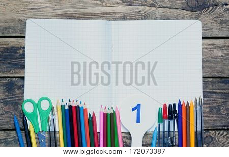 back to school.background.Various school supplies are on the paper sheet.top view.toned