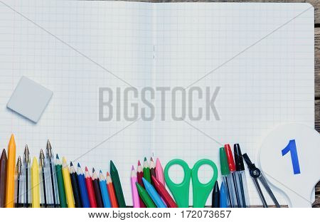back to school.background.Various school supplies are on the paper sheet.top view