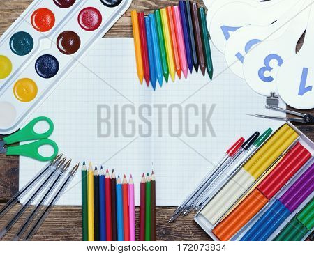 back to school.background.Various school supplies lie on a wooden surface.top view.toned