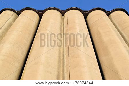 Frog's perspective view of high concrete silos