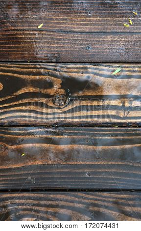 wet wood. wooden flooring outside in the rain. water on wood background
