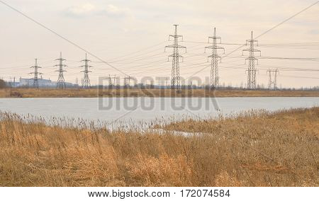 Power line in the countryside at early spring on the outskirts of St. Petersburg Russia.