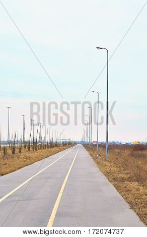 Bike path on the outskirts of St. Petersburg at cloud day Russia.