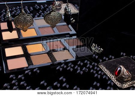Makeup Tools & Silver Accessories On Fur Black Background / Featuring Eyeshadow Palette, Silver Ring