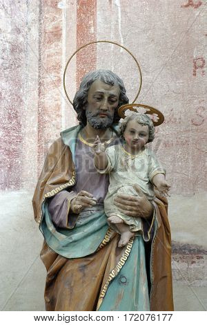 BUCICA, CROATIA - JULY 19: Saint Joseph holding baby Jesus statue on the altar in the parish Church of Saint Anthony of Padua in Bucica, Croatia on July 19, 2016