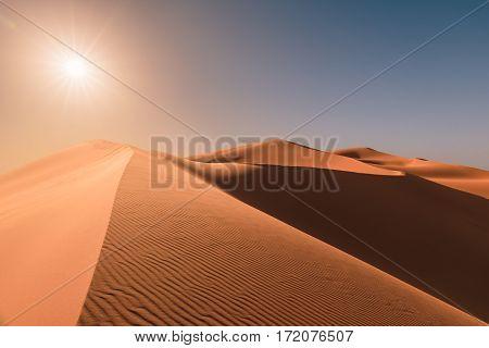 Beautiful sunrise over the dunes of Erg Chebbi near Merzouga in the Sahara, Morocco.