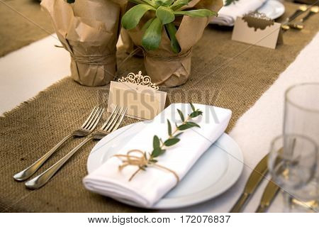 Wedding table setting in rustic style. Eco style. Wedding decoration. Table setting with a sign for the label.