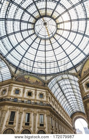 MILAN, ITALY - JUNE 14, 2016: Glass dome of famous Galleria Vittorio Emanuele public Shopping Center in Milan city, Italy