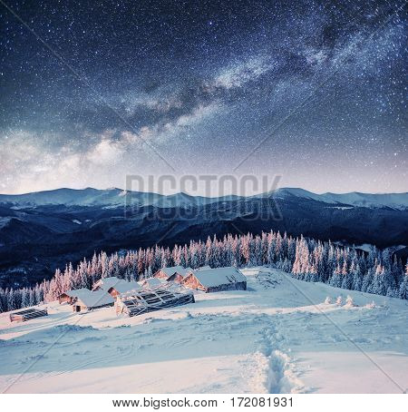 chalets in the mountains at night under the stars. Carpathians, Ukraine, Europe