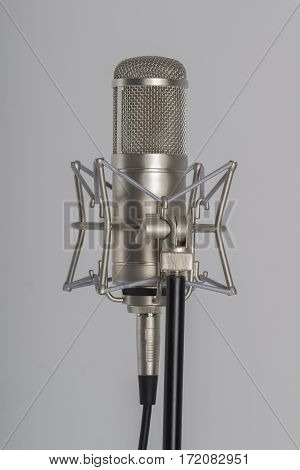 Studio microphone on a grey background. Condenser.