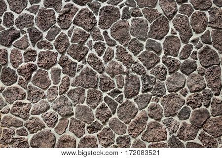 rock wall. volcanic rock wall on Maui Hawaii. Volcanic Stone retaining wall.