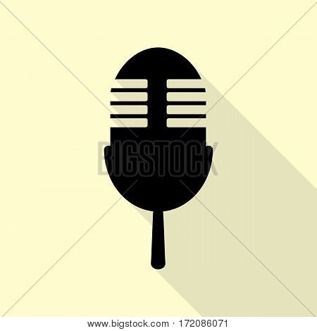 Retro microphone sign. Black icon with flat style shadow path on cream background.