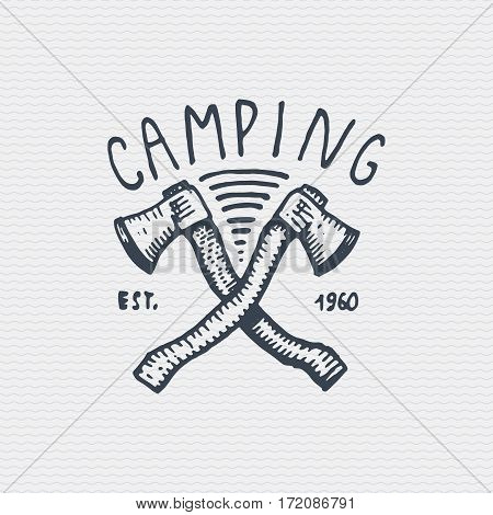 vintage old logo or badge, label engraved and old hand drawn style with two axes.