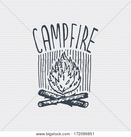 vintage old logo or badge, label engraved and old hand drawn style with campfire.