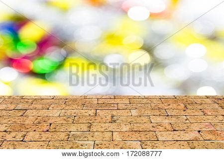 Defocused abstract bokeh background with brick wall