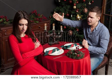 Young man shouts on dissatisfied woman