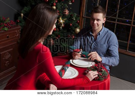Romantic date of young couple at luxury restaurant