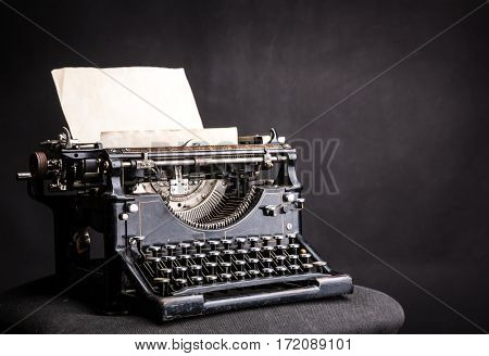 Antique grunge typewrite with inserted paper sheet